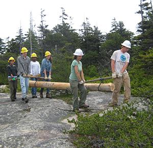 33b_FOAVolunteers_hauling logs