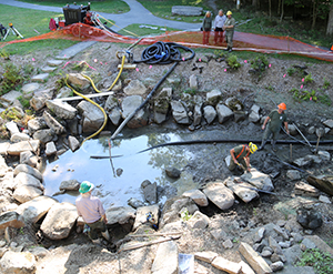 The ANP trails crew reset the historic stones around the pool.