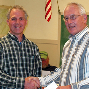 Fred Ehrlenbach, Chairman of the Board of Selectmen (right) and FOA president David MacDonald celebrate the donation of 261 acres to the Town of Trenton.