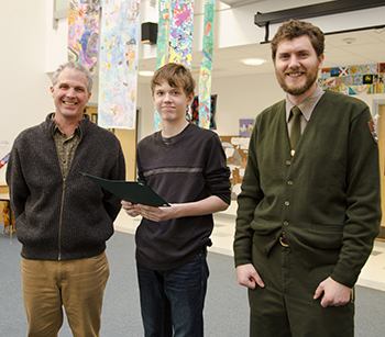 Friends of Acadia President David MacDonald, 2014 Park Pass Art Contest winner Jacob Legutko, and Acadia National Park Revenue and Fee Business Manager Ryan McKelvey (left to right).
