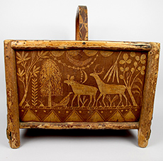 This birchbark log holder by Joseph Nicholas, a Passamaquoddy artist from the late 19th to early 20th century, depicts important food resources for the Wabanaki, especially deer and moose. From the Abbe Museum Collections.