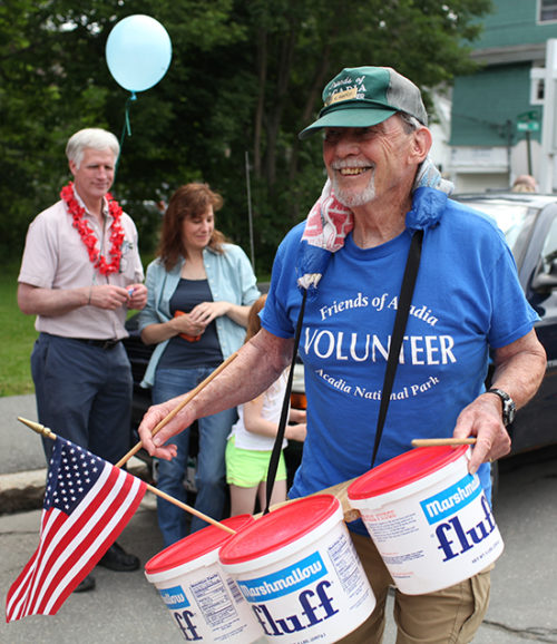 "Al Wiberly plays a mean set of Fluff drums as part of FOA's ""Imprecision Drill Team"" during the Bar Harbor July 4th parade. FOA/Julia Walker Thomas photo."