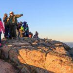 A school group experiences Cadillac Mountain with a park ranger. NPS/Kristi Rugg photo