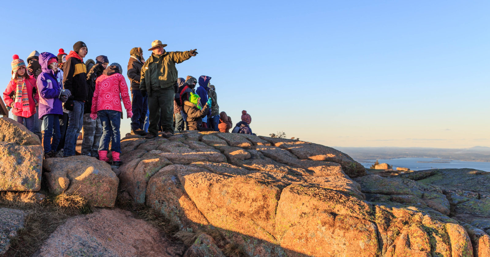 A school group experiences Cadillac Mountain with a park ranger. NPS/Kristi Rugg photo