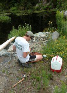 John Overton prepares his fishing gear during mercury-study sampling in Acadia. Credit Natalie Overton